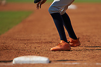 A close-up of the orange Adidas cleats worn by Michael Braswell (14) of Campbell HS in Mableton, GA playing for the Milwaukee Brewers scout team during the East Coast Pro Showcase at the Hoover Met Complex on August 5, 2020 in Hoover, AL. (Brian Westerholt/Four Seam Images)