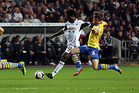 Saturday 28 September 2013<br /> Pictured: Wilfried Bony of Swansea (L)<br /> Re: Barclay's Premier League, Swansea City FC v Arsenal at the Liberty Stadium, south Wales.