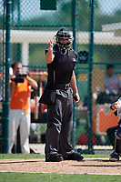 Home plate umpire Kevin Levine calls a strike during a Florida Instructional League game between the Detroit Tigers and the Pittsburgh Pirates on October 2, 2018 at the Pirate City in Bradenton, Florida.  (Mike Janes/Four Seam Images)