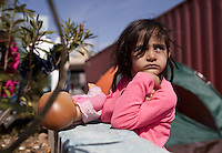 Pictured: A girl at the makeshift camp Monday 07 March 2016<br /> Re: Migrants have been gathering at the port of Piraeus, near Athens, Greece.