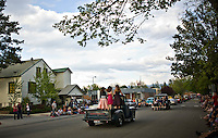 A trio of girls stand in the bed of a 1950's Chevy truck as it drives along Church Street in Sandpoint, following the parade route as a 25th anniversary weekend kicked off in celebration of summer time's arrival. .. (©Matt Mills McKnight/2010)
