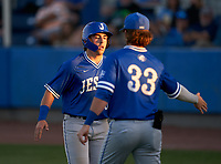 Jesuit Tigers AJ Nessler (5) high fives Nick Rodriguez (33) after scoring a run during a game against the IMG Academy Ascenders on April 21, 2021 at IMG Academy in Bradenton, Florida.  (Mike Janes/Four Seam Images)