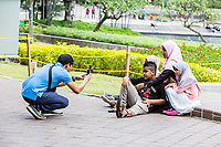 Mother and Children Posing for a Picture, KLCC Park, Kuala Lumpur, Malaysia.