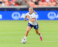 HOUSTON, TX - JUNE 10: Lindsey Horan #9 of the United States brings the ball up the field while looking to pass it during a game between Portugal and USWNT at BBVA Stadium on June 10, 2021 in Houston, Texas.