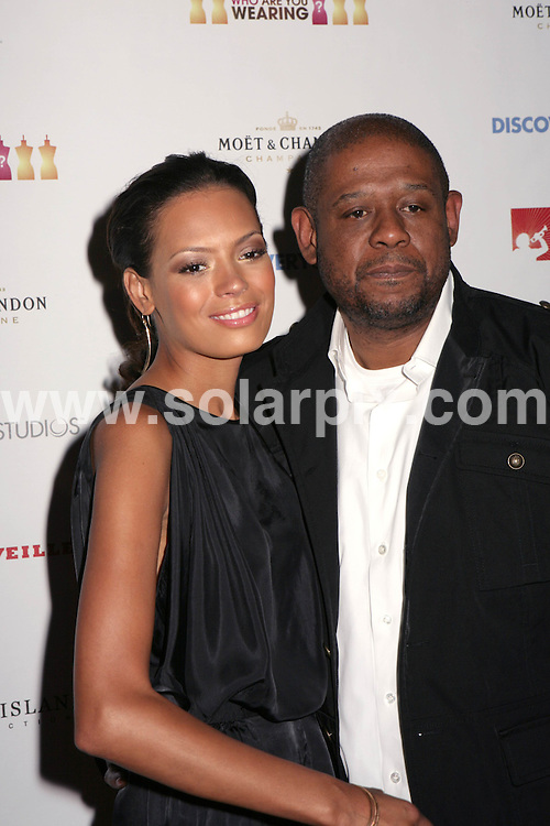 """**ALL ROUND PICTURES FROM SOLARPIX.COM**.**SYNDICATION RIGHTS FOR UK, SPAIN, PORTUGAL, AUSTRALIA, S.AFRICA & DUBAI (U.A.E) ONLY**.Forest Whitaker and Keisha Whitaker at the Premiere Party for TLC's """"Who Are You Wearing"""" at Stork in Los Angeles, USA. August 22, 2008..This pic: Keisha and Forest Whitaker..JOB REF: 7105 PHZ/Tony Lowe  .DATE: 22_08_2008.**MUST CREDIT SOLARPIX.COM OR DOUBLE FEE WILL BE CHARGED* *UNDER NO CIRCUMSTANCES IS THIS IMAGE TO BE REPRODUCED FOR ANY ONLINE EDITION WITHOUT PRIOR PERMISSION*"""