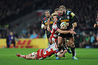 Joe Marler of Harlequins is tackled by Billy Twelvetrees and Billy Burns of Gloucester Rugby during the Aviva Premiership Rugby match between Harlequins and Gloucester Rugby at Twickenham Stadium on Tuesday 27th December 2016 (Photo by Rob Munro/Stewart Communications)