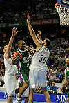 Real Madrid´s Ioannis Bourousis and Unicaja´s Jayson Granger during 2014-15 Liga Endesa match between Real Madrid and Unicaja at Palacio de los Deportes stadium in Madrid, Spain. April 30, 2015. (ALTERPHOTOS/Luis Fernandez)