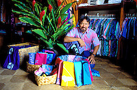 Sig Zane, of Sig Zane Design, in his shop specializing in authentic Hawaiian plant designs on clothing and accessories, downtown Hilo