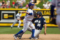 Round Rock Express second baseman Yangevis Solarte #26 turns a double play as New Orleans Zephyrs baserunner Ben Lasater #20 slides into second base during the Pacific Coast League baseball game on April 21, 2013 at the Dell Diamond in Round Rock, Texas. Round Rock defeated New Orleans 7-1. (Andrew Woolley/Four Seam Images)