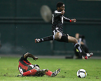 Tiyiseleni Shipalane#21 of D.C. United leaps over Noel Williams #6 of San Juan Jabloteh during a CONCACAF Champions League match on September 30 2009 at RFK Stadium in Washington D.C.United won 5-1.