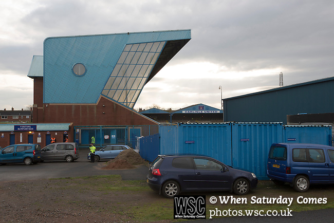 Carlisle United 1 Accrington Stanley 0, 15/11/2014. Brunton Park, League Two. A steward directs car parking outside the Cumberland Building Society stand prior to the English League Two match between Carlisle United and visitors Accrington Stanley at Brunton Park. The match was won by the home team by one goal to nil, the winner scored by Derek Asamoah in the 21st minute. The match was watched by 4,069 spectators. Photo by Colin McPherson.