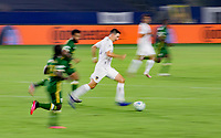 CARSON, CA - OCTOBER 07: Sacha Kljestan #16 of the Los Angeles Galaxy on the run with the balll during a game between Portland Timbers and Los Angeles Galaxy at Dignity Heath Sports Park on October 07, 2020 in Carson, California.