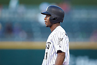 Tim Anderson (11) of the Chicago White Sox stands on first base for the Charlotte Knights on a rehab assignment against the Buffalo Bisons at BB&T BallPark on July 24, 2019 in Charlotte, North Carolina. The Bisons defeated the Knights 8-4. (Brian Westerholt/Four Seam Images)