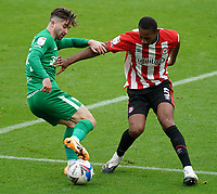 Preston North End's Sean Maguire under pressure from Brentford's Ethan Pinnock<br /> <br /> Photographer Stephanie Meek/CameraSport<br /> <br /> The EFL Sky Bet Championship - Brentford v Preston North End - Sunday 4th October 2020 - Griffin Park - Brentford<br /> <br /> World Copyright © 2020 CameraSport. All rights reserved. 43 Linden Ave. Countesthorpe. Leicester. England. LE8 5PG - Tel: +44 (0) 116 277 4147 - admin@camerasport.com - www.camerasport.com