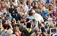 Papa Francesco bacia un bambino al suo arrivo all'udienza generale del mercoledi' in Piazza San Pietro, Citta' del Vaticano, 15 ottobre 2014.<br /> Pope Francis kisses a child as he arrives for his weekly general audience in St. Peter's Square at the Vatican, 15 October 2014.<br /> UPDATE IMAGES PRESS/Isabella Bonotto<br /> <br /> STRICTLY ONLY FOR EDITORIAL USE