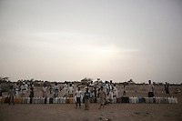 Tuesday 07 July, 2015: Displaced from the heavy fighting in Haradh bordertown queue for water distribution in a temporary settlement at the outskirts of Beni Hassan in Hajjah province, Northwest of Yemen. (Photo/Narciso Contreras)