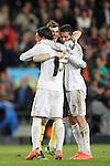Real Madrid's Iker Casillas and Mesut Ozil and Cristiano Ronaldo celebrate victory during la liga match on april 21st 2012...Photo: Cesar Cebolla / ALFAQUI