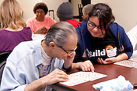 Prosser and Michele Clark High School students participate in buildOn's day of service at the Flannery Senior Apartments in Chicago.