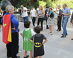 Striking a pose in super hero capes, Mayor Annise Parker, Jack Wallace and Harper Wallace face the media on the steps of City Hall Monday April 13, 2015.  This followed Mayor Parker's reading of a proclamation of April as Child Abuse Prevention Month.(Dave Rossman photo)