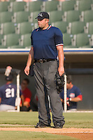 Home plate umpire Bryan Dormaier between innings of the South Atlantic League contest between the Greenville Drive and the Kannapolis Intimidators at Fieldcrest Cannon Stadium in Kannapolis, NC, Sunday August 10, 2008. (Photo by Brian Westerholt / Four Seam Images)