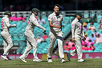 9th January 2021; Sydney Cricket Ground, Sydney, New South Wales, Australia; International Test Cricket, Third Test Day Three, Australia versus India; Pat Cummins of Australia bowls a maiden over and is cogratulat4ed by Nathan Lyon of Australia
