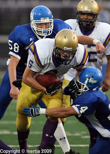 SIOUX FALLS, SD - SEPTEMBER 11: Carter Ahlers #6 of Flandreau bulls his way for yardage as Michael Burns #58 and Mitch Dorhout #44 of Sioux Falls Christian combine for the tackle in the first quarter of the Chargers home opener at the USF Athletic Complex. (Photo by Dave Eggen/Inertia).