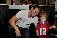 "Days of Our Lives Eric Martsolf ""Brady Black"" poses with fan wearing Tom ""Brady"" shirt as he appears at the 12th Annual Comcast Women's Expo on September 7 (also 2014 at the Connecticut Convention Center, Hartford, CT. He signed photos, posed with fans.  (Photo by Sue Coflin/Max Photos)"