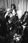 """Paul and Linda McCartney Wings Tour  1975. Paul signing autographs Denny Laine wife JoJo Laine feeds their baby a drink. Manchester. England. The photographs from this set were taken in 1975. I was on tour with them for a children's """"Fact Book"""". This book was called, The Facts about a Pop Group Featuring Wings. Introduced by Paul McCartney, published by G.Whizzard. They had recently recorded albums, Wildlife, Red Rose Speedway, Band on the Run and Venus and Mars. I believe it was the English leg of Wings Over the World tour. But as I recall they were promoting,  Band on the Run and Venus and Mars in particular."""