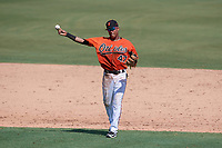 Baltimore Orioles shortstop Milton Ramos (47) warmup throw to first base during an Instructional League game against the Atlanta Braves on September 25, 2017 at Ed Smith Stadium in Sarasota, Florida.  (Mike Janes/Four Seam Images)