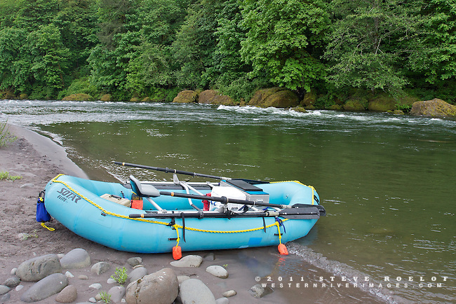 A raft rests on the beach along the Sandy River, Oregon.