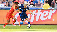 Sandy, Utah - Thursday June 07, 2018: Lou Jiahui, Megan Rapinoe during an international friendly match between the women's national teams of the United States (USA) and China PR (CHN) at Rio Tinto Stadium.