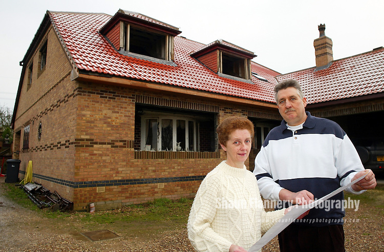 Pix, Shaun Flannery. ..COPYRIGHT PICTURE>>SHAUN FLANNERY>>01302-570814>>..3rd January 2003.........  Kevin & Trish Appleyard pictured at the site of their new home which is being built around their existing bungalow, Windrush, Morthern Road, Thurcroft nr. Rotherham, S. Yorks.