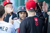 Jason Martin (2) of the Indianapolis Indians is greeted in the dugout after scoring at Victory Field on May 14, 2019 in Indianapolis, Indiana. The Indians defeated the RailRiders 4-2. (Andrew Woolley/Four Seam Images)