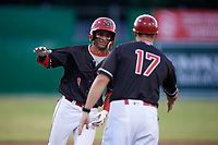 Batavia Muckdogs second baseman Gerardo Nunez (1) is congratulated by manager Mike Jacobs (17) as he rounds the bases after hitting a home run in the bottom of the seventh inning during a game against the West Virginia Black Bears on June 20, 2018 at Dwyer Stadium in Batavia, New York.  West Virginia defeated Batavia 4-3.  (Mike Janes/Four Seam Images)