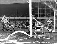 1969 FA Cup semi final  Everton v Manchester City..Streamers fly as a shot from Tom Booth (striped shirt, left), the Manchester City centre half, beats Gordon West, the Everton goalkeeper to put Manchester City in the FA Cup final. Tommy Wrighht and T.Jackson (No.12) both on the goal line fail to stop the ball from crossing the line. Other players watching are (left to right) Sandy Brown, Brian Labone, and John Hurst of Everton, with Colin Bell of Manchester City..22nd March 1969.
