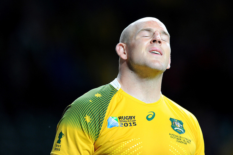 Stephen Moore of Australia shows his relief after securing the top spot in Pool A at the end of Match 35 of the Rugby World Cup 2015 between Australia and Wales - 10/10/2015 - Twickenham Stadium, London<br /> Mandatory Credit: Rob Munro/Stewart Communications
