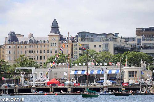 The Royal St. George Yacht Club, with the town's Royal Marine Hotel in the background