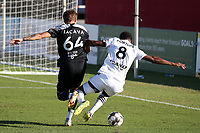 RICHMOND, VA - SEPTEMBER 30: Jake LaCava #64 of New York Red Bulls II fouls Dre Fortune #8 of North Carolina FC in the penalty area leading to a penalty kick during a game between North Carolina FC and New York Red Bulls II at City Stadium on September 30, 2020 in Richmond, Virginia.