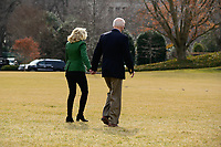 United States President Joe Biden and first lady Jill Biden hold hands as they walk on the South Lawn of the White House before boarding Marine One in Washington, D.C., U.S., on Friday, Feb. 26, 2021. Biden is visiting Texas today to discuss recovery efforts after winter weather caused widespread damage and left millions without power.<br /> Credit: Erin Scott / Pool via CNP /MediaPunch