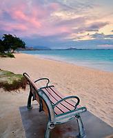 Bench with sunrise clouds and ocean. Kailua Beach Park, Oahu, Hawaii