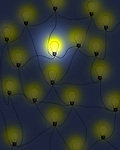 Concept image of connected light bulbs in the dark with one lit up representing creative thought and ideas
