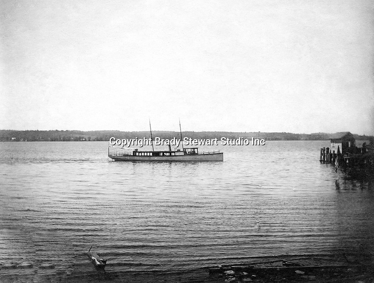 Lakewood NY:  Small Tour boat arriving at the Kent House pier.  Photographs were taken during a church field trip to Chautauqua Institution in New York (Lake Chautauqua). The Stewart family and friends visited Chautauqua during 1901 to hear Stewart's relative, Dr. S.H. Clark speak at the institute. Alice Brady Stewart chaperoned and Brady Stewart came along to photograph the trip.  The Gallery provides a glimpse of how the privileged and church faithful spent summers at Lake Chautauqua at the turn of the century.