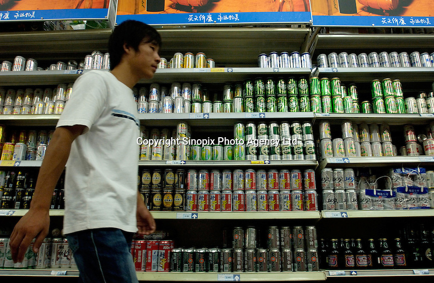 Tin beers are on sale in Wumei supermarket in Beijing, China. .22 Jul 2006