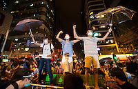 Jubilant pro-democracy protesters are seen celebrating after the Hong Kong police lost control of Mong Kok, ceding it back to the protesters, who had only just lost it to the police hours earlier in a pre-dawn raid, Mong Kok, Kowloon, Hong Kong, China, 18 October 2014.
