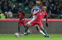 Leiria, Portugal - Tuesday November 14, 2017: Kellyn Acosta, João Mário during an International friendly match between the United States (USA) and Portugal (POR) at Estádio Dr. Magalhães Pessoa.