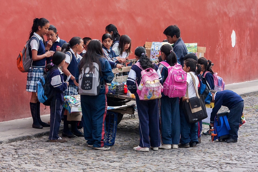 Antigua, Guatemala.  School Children at Vendor's Cart.