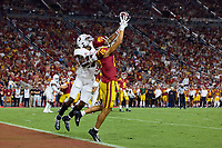 LOS ANGELES, CA - SEPTEMBER 11: Kyu Blu Kelly #17 of the Stanford Cardinal breaks up a pass intended for Drake London #15 of the USC Trojans during a game between University of Southern California and Stanford Football at Los Angeles Memorial Coliseum on September 11, 2021 in Los Angeles, California.