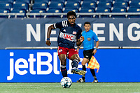 FOXBOROUGH, MA - AUGUST 26: Jon Bell #70 of New England Revolution II passes the ball during a game between Greenville Triumph SC and New England Revolution II at Gillette Stadium on August 26, 2020 in Foxborough, Massachusetts.