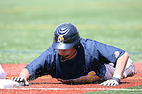 May 15, 2009:  Brad Medici of Canisius College dives back to first on a pick off attempt during a game at Demske Sports Complex in Buffalo, NY.  Photo by:  Mike Janes/Four Seam Images