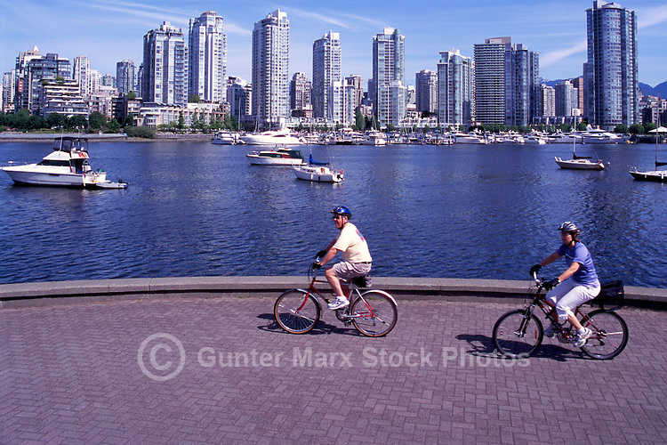 Vancouver, BC, British Columbia, Canada - City Skyline at False Creek and Yaletown, People cycling on Seawall, Summer